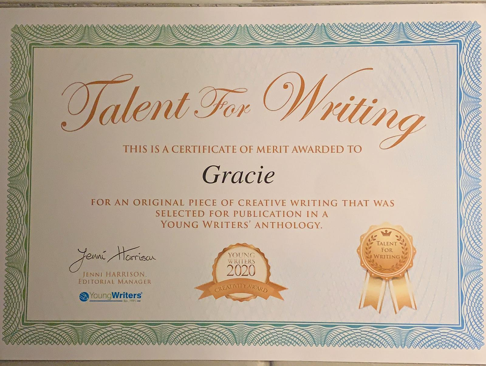 Grace holding her certificate saying Young Writers 2020 Creativity Award