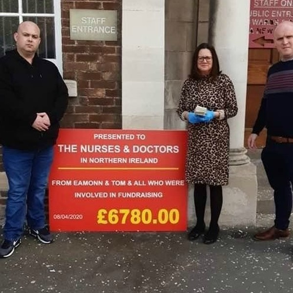 travellers outside a hospital raising money