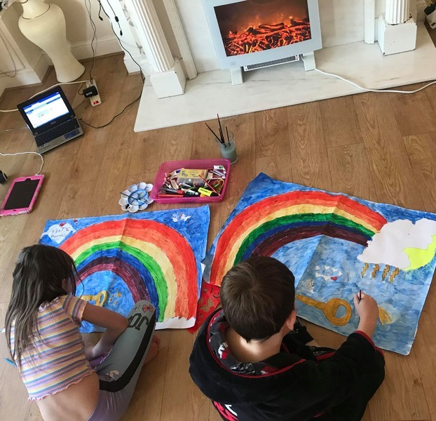 Kids drawing rainbows