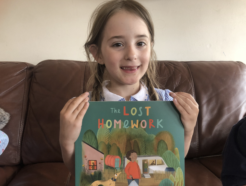 Isabelle Smith holding a copy of the lost homework by Richard O'Neill