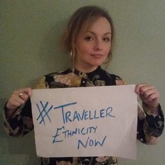 Amy Ward holding up #Traveller Ethnicity Now Campaign