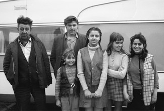 Father and son, young girl, two teenagers and young woman.  Early 1971. Barnsley. South Yorkshire. © KIERON FARROW.