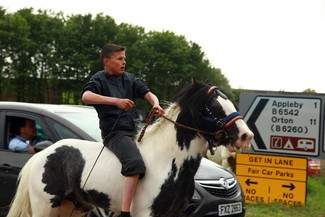 Appleby Horse Fair boy on horse youth gypsy cobb road sign
