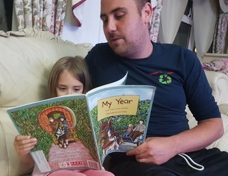 Young Dad reading with daughter
