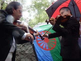 Romani musicians play at the Holocaust Memorial Gardens, Hyde Park, London, on August 2nd, 2016, for Roma Holocaust Remembrance Day © free please credit TT/Mike Doherty