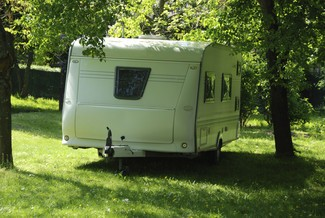 Caravan under a tree