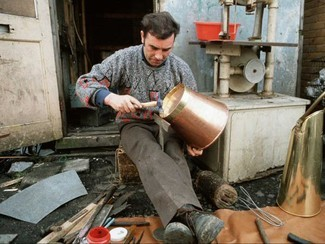 The decline of tin smithing, one of many traditional trades associated with Travellers