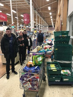 Travellers donating at food banks