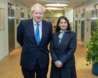 Boris Johnson with Priti Patel – The Conservative's 'thumping' majority in Parliament means that opposition parties will find it hard to stop any new laws