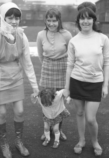 Mother and daughter with teenager and young woman. 1971. Barnsley. South Yorkshire. © KIERON FARROW.