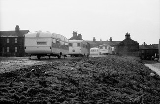 Travellers trailers on waste ground recently cleared of terrace houses. Early 1971. Barnsley. South Yorkshire. © KIERON FARROW.