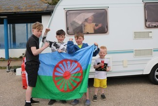 Children and a Romani Flag